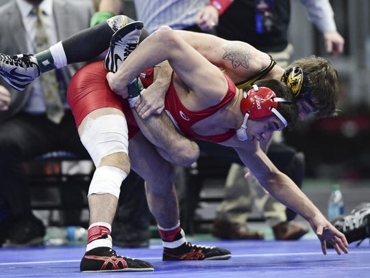 Cornell's Yianni Diakomihalis, bottom, and Missouri's