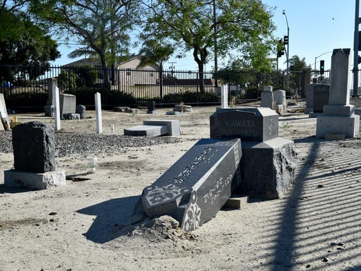 An obelisk headstone lies on the ground at the Historic