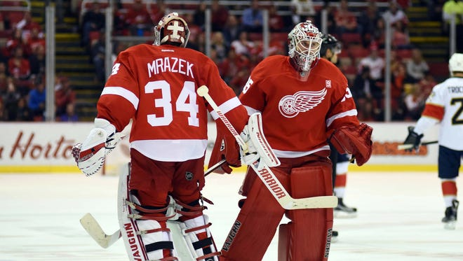 Red Wings goalie Petr Mrazek (34) is pulled out and replaced by goalie Jimmy Howard (35) during the second period against Panthers at Joe Louis Arena on Oct. 16.