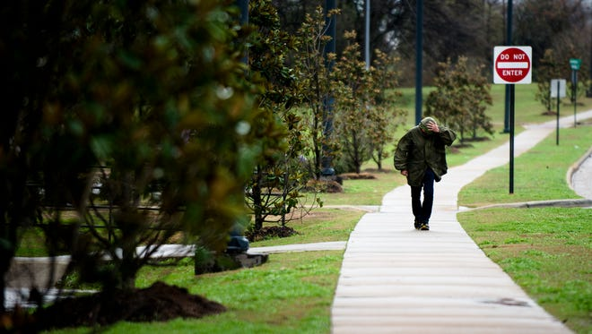 A pedestrian walks through the wind in Montgomery on Jan. 22. Through Thursday, the Montgomery area has received 11.17 inches of rainfall for January, that's about 7.38 inches above the normal tally of 3.79 inches, National Weather Service Data shows.