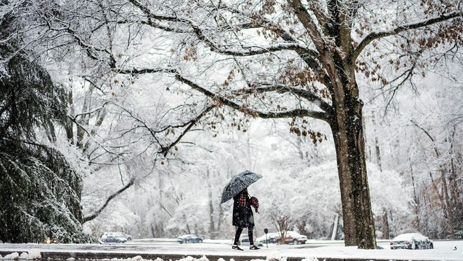 East Columbus High School senior Annaelise Kennedy, 17, returns after touring Wake Forest University's campus as snow falls on Dec. 8, 2017, in Winston-Salem, N.C.
