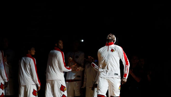 Louisville's Montreal Harrell let's the crowd hear him during the team's introductions. 