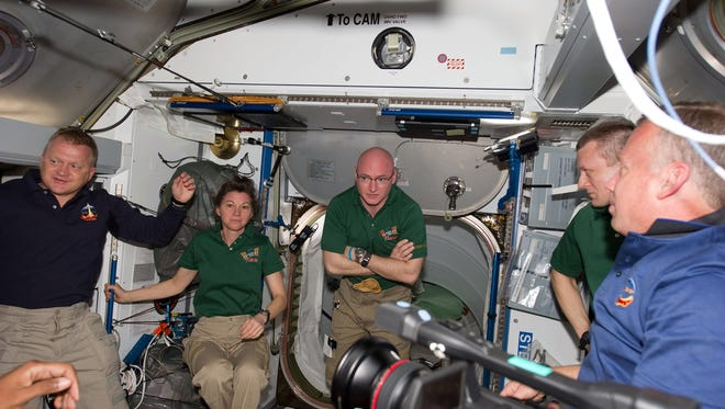 IN SPACE - FEBRUARY 26:  In this handout image provided by NASA, (L-R) STS-133 and Expedition 26 crew members NASA astronauts Eric Boe, STS-133 pilot; Catherine (Cady) Coleman, Expedition 26 flight engineer; Scott Kelly, Expedition 26 commander; Russian cosmonaut Dmitry Kondratyev, Expedition 26 flight engineer; and NASA astronaut Steve Lindsey, STS-133 commander meet in the Harmony node of the International Space Station shortly after space shuttle Discovery and the space station docked in space and the hatches were opened February 26, 2011 in Space. Discovery, on its 39th and final flight, is carrying the Italian-built Permanent Multipurpose Module (PMM), Express Logistics Carrier 4 (ELC4) and Robonaut 2, the first humanoid robot in space to the International Space Station.  (Photo by NASA via Getty Images)