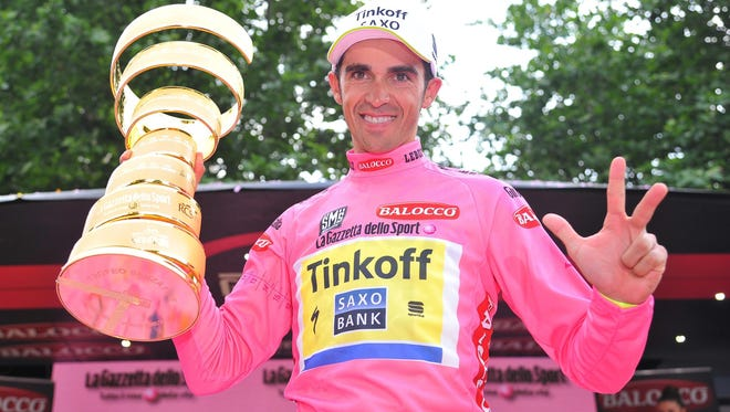 Alberto Contador of the Tinkoff-Saxo holds the trophy after winning the 98th Giro d'Italia cycling tour, following the 21st and last stage.