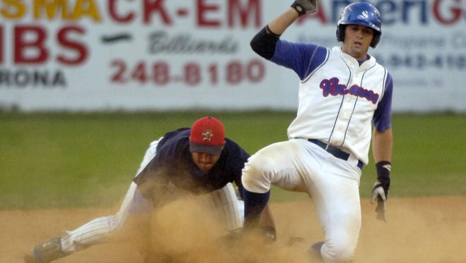 Stanton Braves' player slides into second as a Waynesboro Generals' player loses his footing.