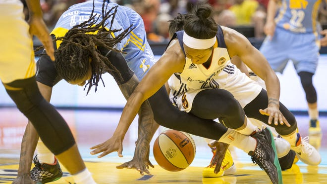 Briann January (right) of Indiana, and Jessica Breland of the Chicago Sky hunt for a loose ball during second quarter action at the Indiana Fever, Bankers Life Fieldhouse, Indianapolis, Friday, June 26, 2015.