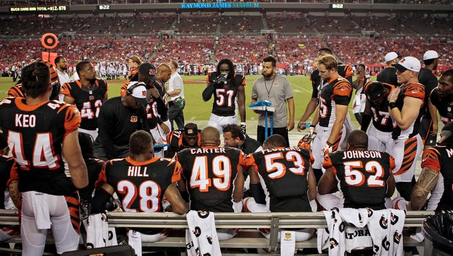 The Cincinnati Bengals defense regroups during the third quarter of the NFL pre-season game between the Cincinnati Bengals and the Tampa Bay Buccaneers at Raymond James Stadium in Tampa, Fla., on Monday, Aug. 24, 2015. The Bengals fell to 1-1 in the preseason with a 25-11 loss in Tampa.
