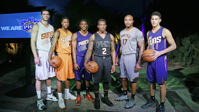 Phoenix Suns players from left, Jon Leuer Archie Goodwin, Brandon Knight, Eric Bledsoe, P.J. Tucker and Devin Booker wear their uniform combinations during a gathering Tuesday, Sept. 8, 2015 The Canyon Suites at The Phoenician in Scottsdale, Ariz. Bledsoe's black uniform was unveiled for the first time.