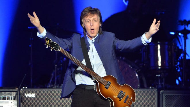 """Paul McCartney greets the crowd at the start of his """"One on One"""" tour on Wednesday, April 13, 2016, at the Save Mart Center in Fresno, Calif. (Silvlia Flores/Fresno Bee/TNS)"""
