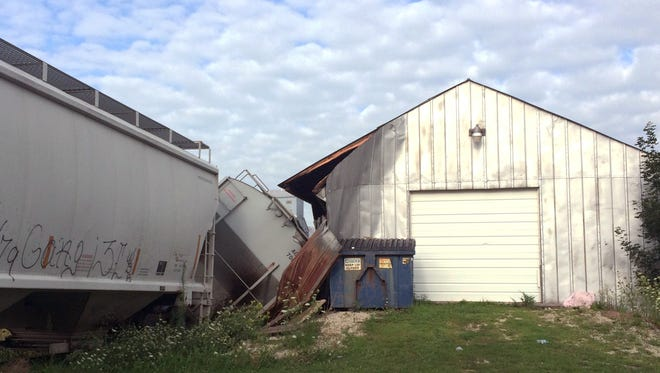 A freight train car that derailed in Charles City, in northern Iowa, derailed into and damaged a trackside tavern called DeRailed early Tuesday, Aug. 9, 2016. Charles City Police Chief Hugh Anderson says the accident occurred around 4 a.m. Tuesday as crews moved rail cars and changed connections. No one was injured.