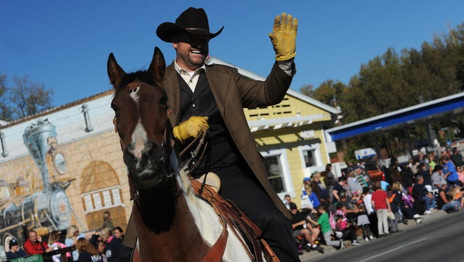Senator Dean Heller waves to the crowd during the Nevada Day parade and celebration in Carson City on Oct. 31, 2015.
