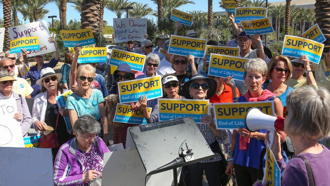 A group of supporters of the End Of Life Option Act protests in front of Eisenhower Medical Center in Rancho Mirage, March 2, 2017.
