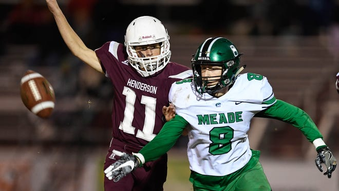 Henderson County's Garrett Greenwell defends Meade County's Cole Miller (8) on a incomplete pass during the Colonels' 21-14 playoff win last season at Colonel Field on Friday, November 3, 2017.