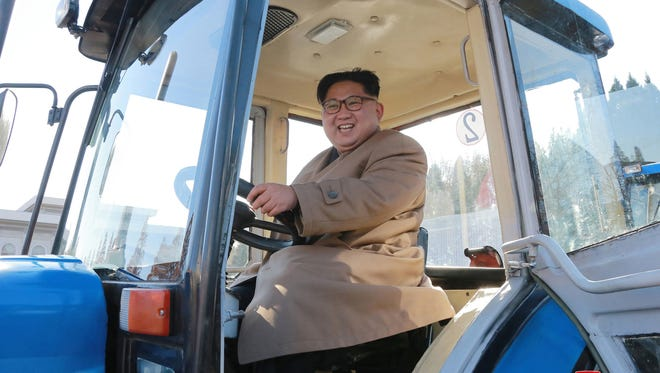 "In this undated photo provided on Wednesday, Nov. 15, 2017, by the North Korean government, North Korean leader Kim Jong Un sits in a tractor at the Kumsong Tractor Factory, in Nampo, North Korea. Independent journalists were not given access to cover the event depicted in this image distributed by the North Korean government. The content of this image is as provided and cannot be independently verified. Korean language watermark on image as provided by source reads: ""KCNA"" which is the abbreviation for Korean Central News Agency. (Korean Central News Agency/Korea News Service via AP) ORG XMIT: KNS801"