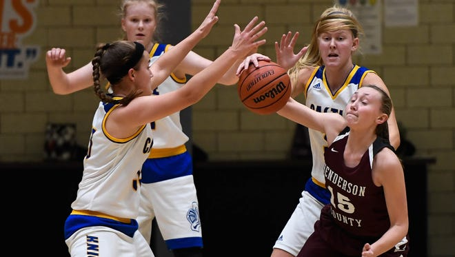 Henderson County's Alyssa Dickson is surrounded by Castle defenders during the Dec. 5 in Newburgh. The Lady Colonels will begin play Thursday in the Owensboro Invitational Tournament, an event they have won the last three years.
