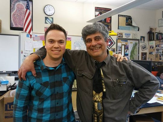 Ty Brewen, left, a student at West Salem High School, stands with Michael Lampert. Lampert retired from 30 years of teaching science in May 2017.