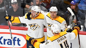 Nashville Predators center Colton Sissons (10) celebrates his goal with defensemen Alexei Emelin (25) and Mattias Ekholm (14)  during the second period of game 4 in the first round NHL Stanley Cup Playoffs at the Pepsi Center, Wednesday, April 18, 2018, in Denver, Colo.