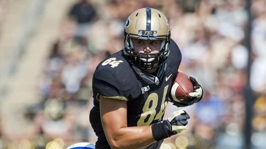 Tight end Justin Sinz and his Purdue teammates have put last season's troubles behind them.