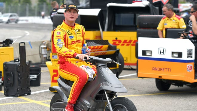 Jul 14, 2017; Toronto, Ontario, CAN;  Verizon IndyCar series driver Ryan Hunter-Reay (28) prepares to leave his pit box on a motorbike after practice for the Honda Indy Toronto at Streets of Toronto.