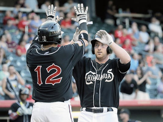 MARK LAMBIE-EL PASO TIMES  El Paso's Jedd Gyorko, right, celebrates his two-run homer with teammate Ramiro Pena after reaching home plate Friday during their series opener against the Salt Lake Bees.