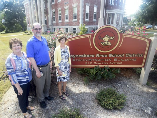 Sherian Diller, left, superintendent of Waynesboro Area School District, stands with educators Ken Carlson and Nancy Kauffman, who are nominated as teachers of the year.