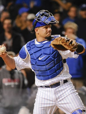 Chicago Cubs catcher Kyle Schwarber warms up against the Cleveland Indians in the ninth inning at Wrigley Field.