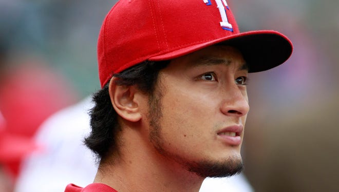 Texas Rangers starting pitcher Yu Darvish (11) on the bench before the game against the Detroit Tigers at Globe Life Park in Arlington. Detroit beat the Texas 8-6.