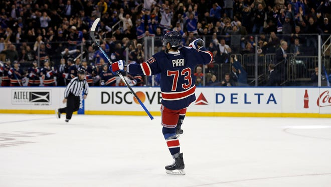 Rangers winger Brandon Pirri (73) celebrates scoring a goal during the second period against the Bruins.