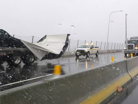 Truck flips on the Gov. Mario M. Cuomo Bridge