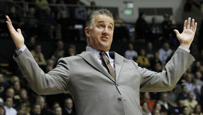 Coach Matt Painter reacts to a foul call against the Boilermakers as they battle Gardner-Webb on Monday, while the Mackey Arena crowd reacted with boos for Purdue's basketball squad during an 89-84 loss.