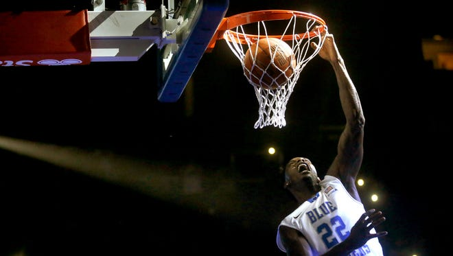 MTSU's Jacorey Williams comes from behind the goal to land a dunk in the dunk contest during MTSU's  Murphy Madness on Thursday Oct 29, 2015.