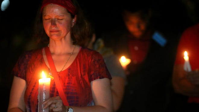 Mandy Ray-Jones participates in a candle light vigil for vicitms of the Orlando night club shooting on the steps of the Rutherford County Courthouse, on Sunday, June 12, 2016. Ray-Jones also spoke at the event.
