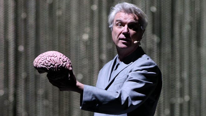 David Byrne performs during his American Utopia Tour at the Mesa Arts Center in Mesa on Thursday, April 19, 2018.