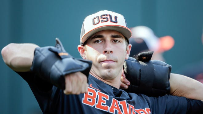 Oregon State pitcher Luke Heimlich works with weights during practice at TD Ameritrade Park in Omaha, Neb., Friday, June 15, 2018. Oregon State plays North Carolina on Saturday in the NCAA College World Series baseball tournament.. (AP Photo/Nati Harnik)