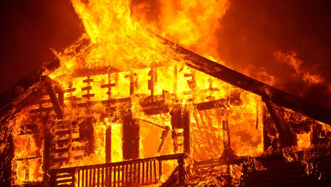 A home  burns in the Thomas Fire in Ventura in the early morning hours of Dec. 5, 2017.
