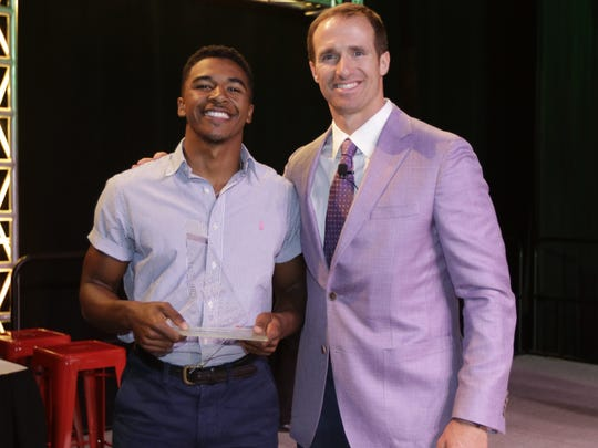 Drew Brees congratulates Cecilia's Raymond Calais at  the Acadiana Best of Preps Awards at the Cajundome Convention Center on Tuesday night. Raymond was named Male Athlete of the Year.