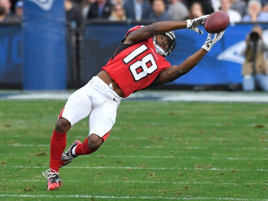 Atlanta Falcons wide receiver Taylor Gabriel can't grab a pass during the first half against the Los Angeles Rams on Sunday, Dec. 11, 2016, in Los Angeles.