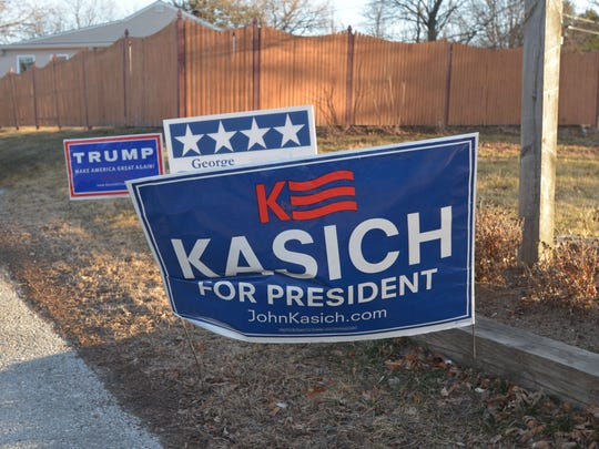 A sign for Republican presidential candidate Gov. John Kasich of Ohio is planted at the entrance of the Orchard School, a South Burlington, Vt., polling station, on Tuesday, March 1, 2016.