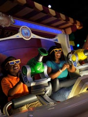 "Guests enjoy the new ""Toy Story Mania!"" attraction"