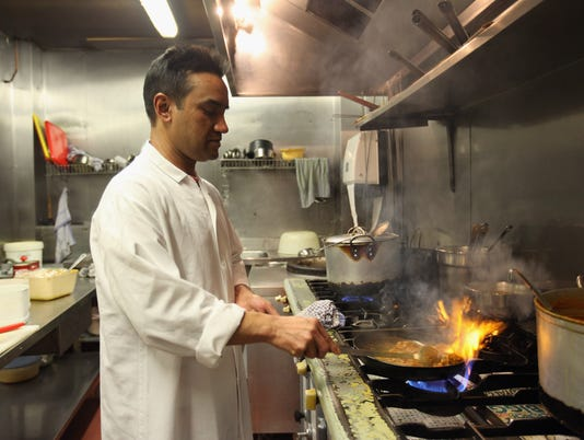 Curry Houses In Brick Lane As Concerns Rise Over The New Laws Regarding Immigrant Workers Loom
