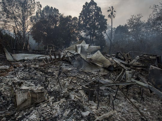 The ruins of a house that was destroyed by the Thomas Fire are seen on Dec. 10, 2017 near Carpinteria, Calif.