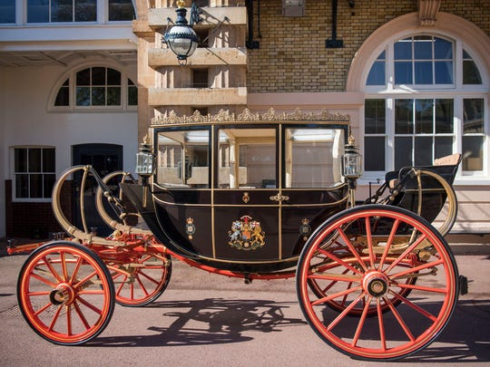 The Scottish State Coach, which will be used in the case of wet weather, during preparations for the wedding of Britain's Prince Harry and Meghan Markle, in the Royal Mews at Buckingham Palace in London on May 1, 2018.