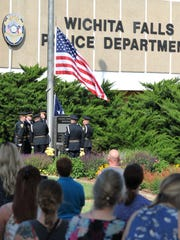 The Wichita Falls police honor guard raised the American flag during the WFPD's annual Police Memorial Service.