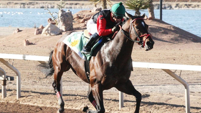 Dirt Monster, with Alfredo Juarez Jr., aboard, pulls clear in the stretch to post an impressive win in Sunday's $75,000 Budweiser Handicap at Sunland Park Racetrack and Casino.