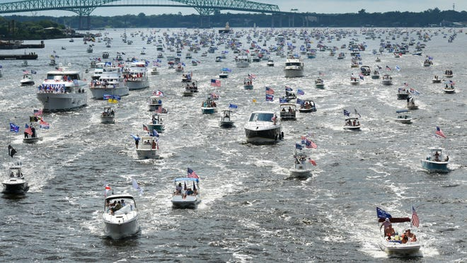 Hundreds of boats idle through downtown on the St. Johns River during the Trump's Birthday Boat Rally Sunday, June 14, 2020 in Jacksonville, Florida.  A similar event is planned Saturday on Thurmond Lake.