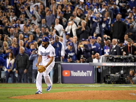 Los Angeles Dodgers relief pitcher Kenley Jansen celebrates after their win against the Houston Astros in Game 6 of baseball's World Series Tuesday, Oct. 31, 2017, in Los Angeles. The Dodgers won 3-1 to tie the series at 3-3. (AP Photo/Mark J. Terrill)