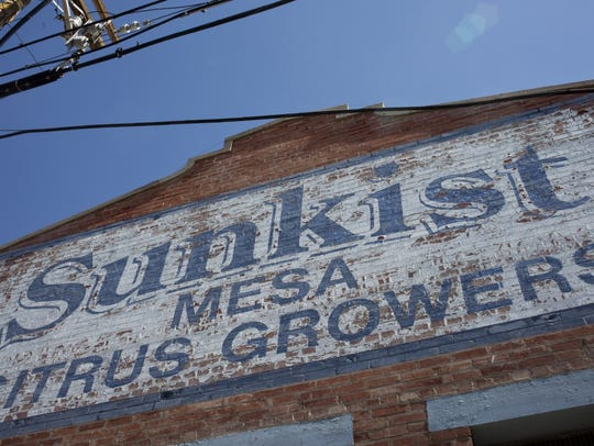 Workers renovating the historic Sunkist packing plant