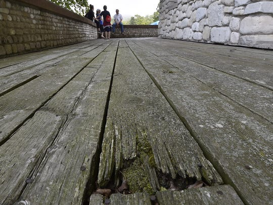 Some of the decaying decking boards in need of replacement surrounding Rock Island's boathouse.