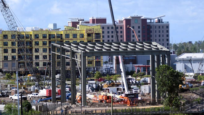 Construction of North Waterfront Front Park and nearby apartments downtown.