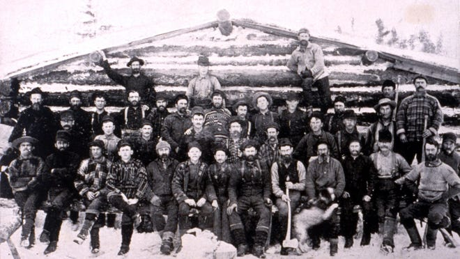 This photo shows W.C. Sterling Company loggers posing for a picture, circa 1870s. W.C. Sterling's Monroe logging operations supplied logs to lumber operations throughout the Great Lakes and elsewhere during the latter half of the 19th Century.
